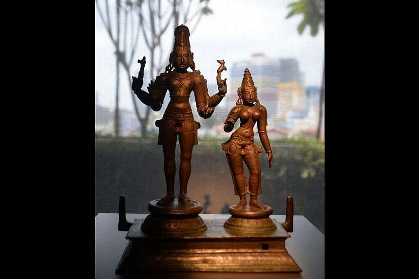 ARTEFACTS ON SHOW: Chola bronze figures of the divine couple Shiva and Parvati from Tamil Nadu. -- ST PHOTO: MARK CHEONG