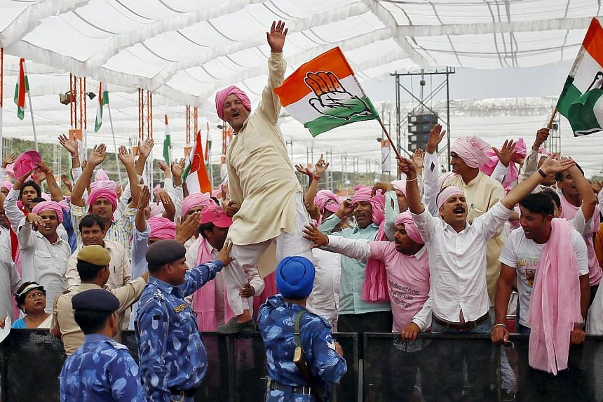 Mr Rahul Gandhi (left) has tapped into the anger of farmers who shouted support for him at a recent rally in New Delhi (above). The farmers are unhappy with the government's land acquisition Bill, which makes it easier for businesses to buy land.