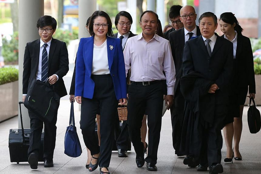 AHPETC and WP chairman Sylvia Lim, fellow Aljunied GRC MP Muhamad Faisal Abdul Manap (middle), lawyer Peter Low (second from right) and the rest of the town council's legal team arriving at the High Court yesterday.