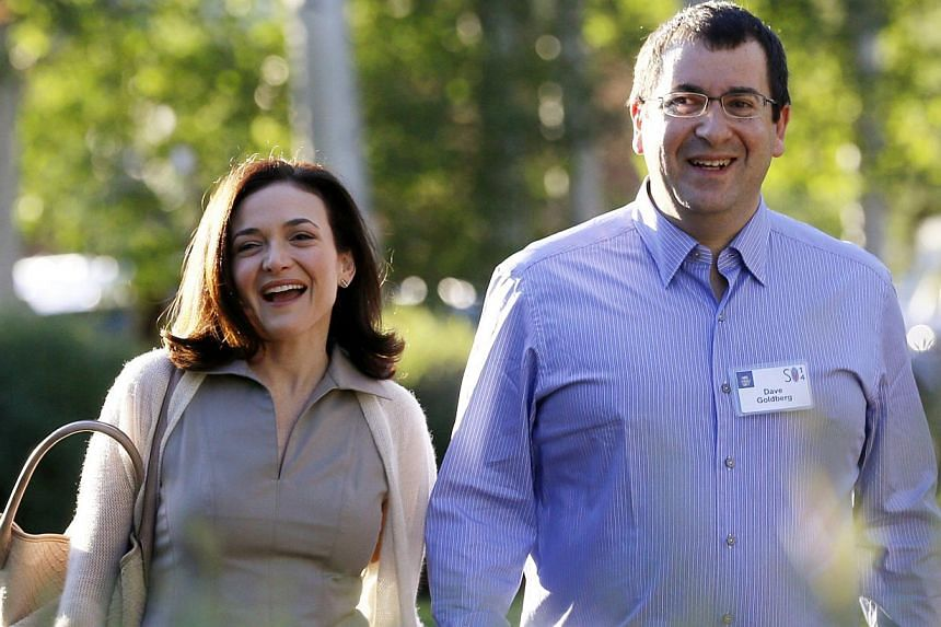 Sheryl Sandberg, (left), Chief Operating Officer (COO) of Facebook, arriving with her husband David Goldberg, CEO of SurveyMonkey, for the first day of the Allen and Co. media conference in Sun Valley, Idaho on July 9, 2014. Goldberg died Friday from