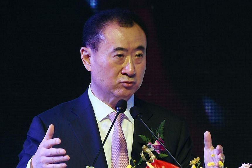Wang Jianlin, chairman of Wanda Group, speaks at a ceremony in Beijing on Feb 10, 2015. -- PHOTO: AFP