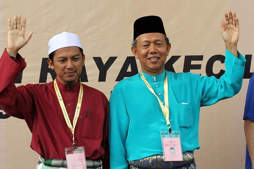 Mr Nazri Ahmad (left) of Parti Islam seMalaysia (PAS) and Datuk Hasan Arifin of Barisan Nasional (BN), the two candidates for the Rompin by-election, waving to their supporters. Polling for the by-election closed at 5pm, with voter turnout standing a
