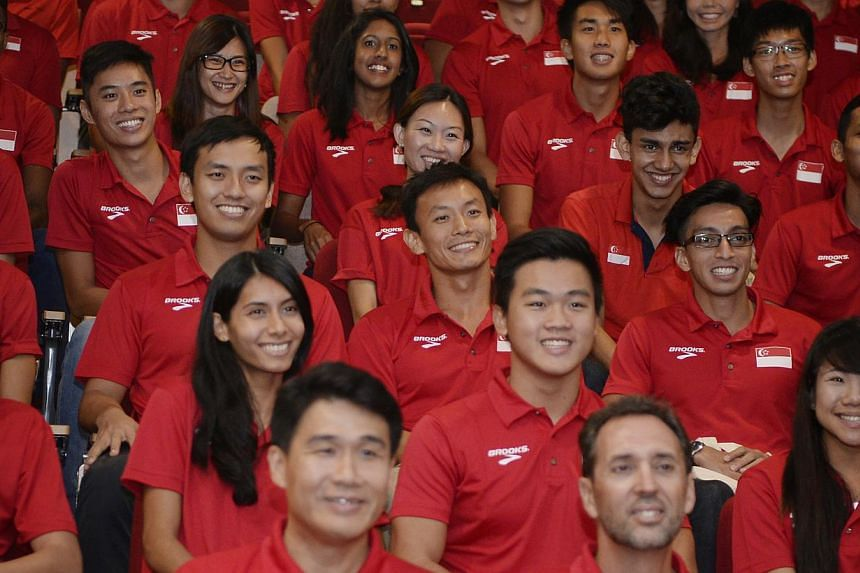 The SEA Games Athletics contingent takes a group photograph after receiving their tournament vests on May 4, 2015. Singapore has assembled its largest-ever contingent of 748 athletes from 36 sports to represent the Republic at this year's SEA Games.