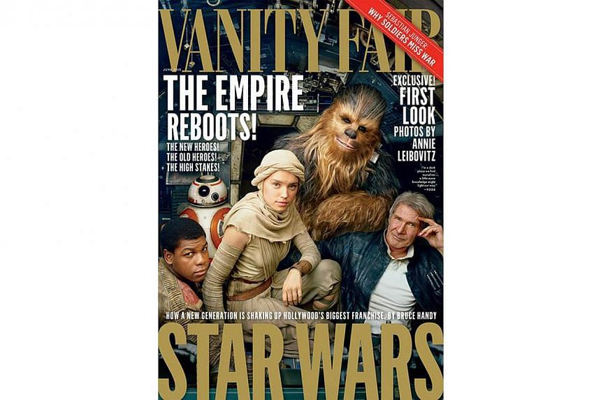The Vanity Fair cover which shows Star Wars: The Force Awakens characters (from right) Han Solo (Harrison Ford) with the wookie Chewbacca, and newcomers Rey (Daisy Ridley), the droid BB-8 and Finn (John Boyega). -- PHOTO: VANITY FAIR/TWITTER