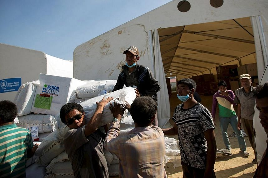 Workers loading relief material onto a truck for earthquake victims at the cargo terminal of international airport in Kathmandu, Nepal on May 3, 2015. -- PHOTO: REUTERS