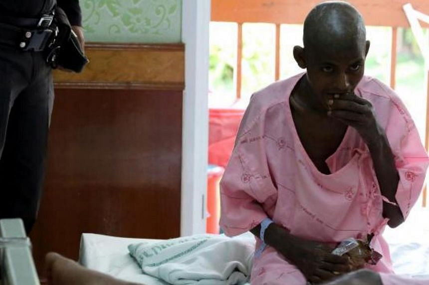An illegal migrant, one of four found alive near a mass grave in an area bordering Malaysia, is treated at Padang Besar Hospital in Songkhla, Thailand. -- PHOTO: THE NATION/ASIA NEWS NETWORK