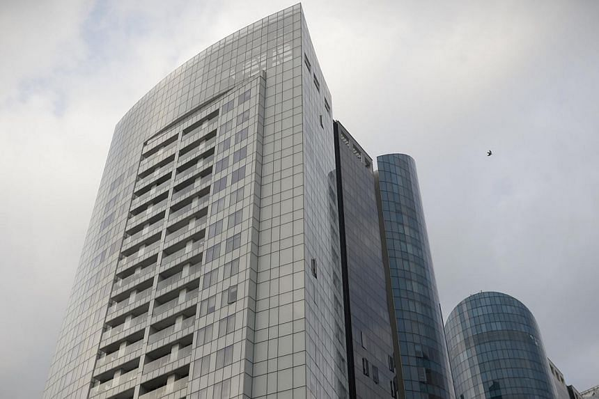 Japanese tycoon Katsumi Tada's eye-popping $15.8 million loss on a penthouse unit at St Regis Residences (above) earlier this year is part of a rise in the pace of loss-making transactions in the residential market in 2015. -- ST PHOTO: MARK CHEONG&n