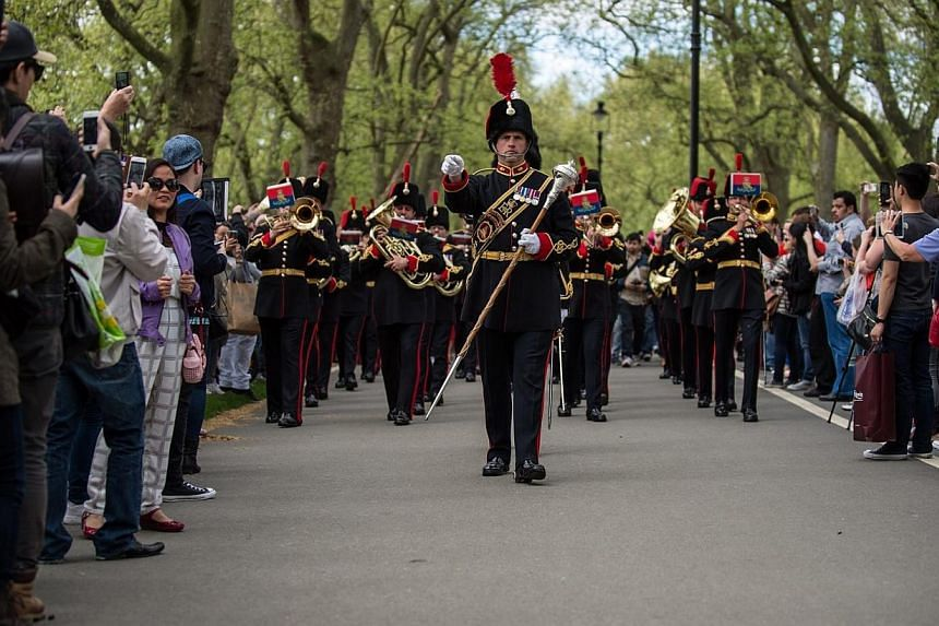 The Royal Artillery Band, whose musicians had been up since dawn practising special arrangements of music suitable to welcome the new Princess, entertained the expectant crowds in the Royal Park with familiar tunes, from Stevie Wonder's Isn't She Lov
