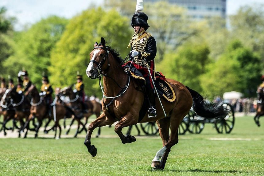 Fifty-three soldiers and 71 horses pulling six First World War-era Ordnance Quick Fire 13-Pounder Field Guns came dramatically into action to place the Guns into position for the 41-Royal Gun Salute near Park Lane at Hyde Park in London on Monday in