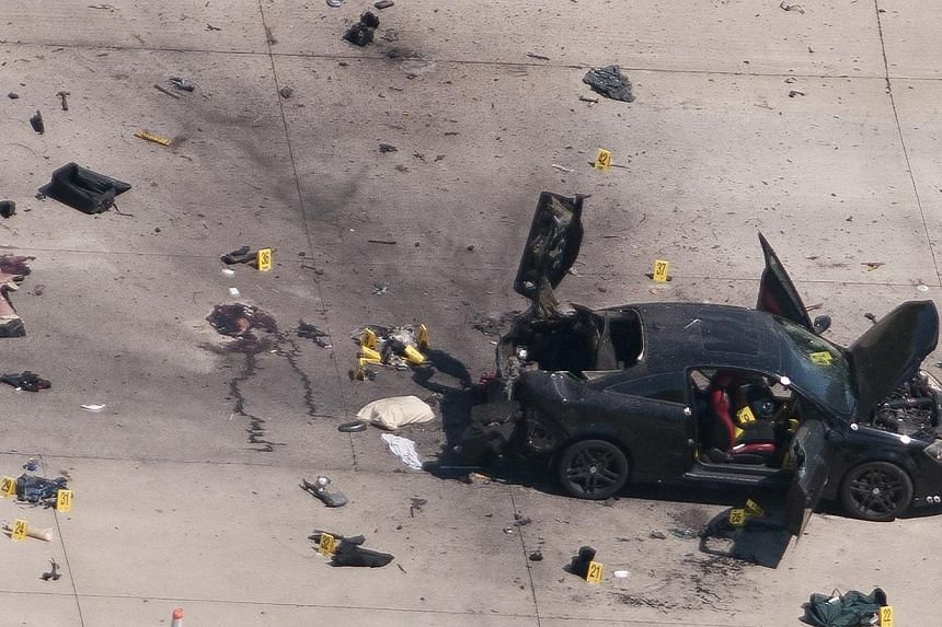 An aerial view shows the car that was used the previous night by two gunmen, who were killed by police, as it is investigated by local police and the FBI in Garland, Texas on Monday. -- PHOTO: REUTERS