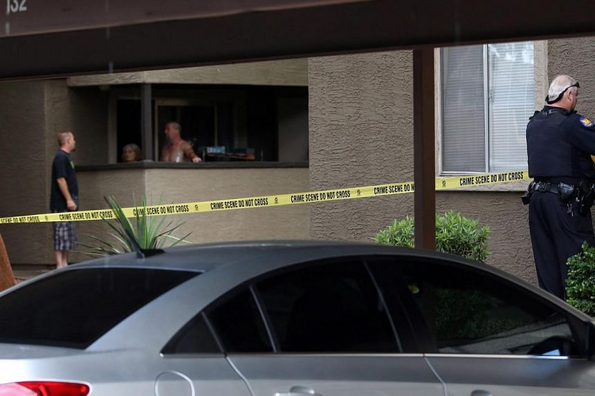 Phoenix Police set up crime tape near the home of one of the gunmen who opened fire at a Muhammad Art Exhibit and Contest the day before in Texas, at an apartment complex in Phoenix, Arizona on Monday. -- PHOTO: EPA