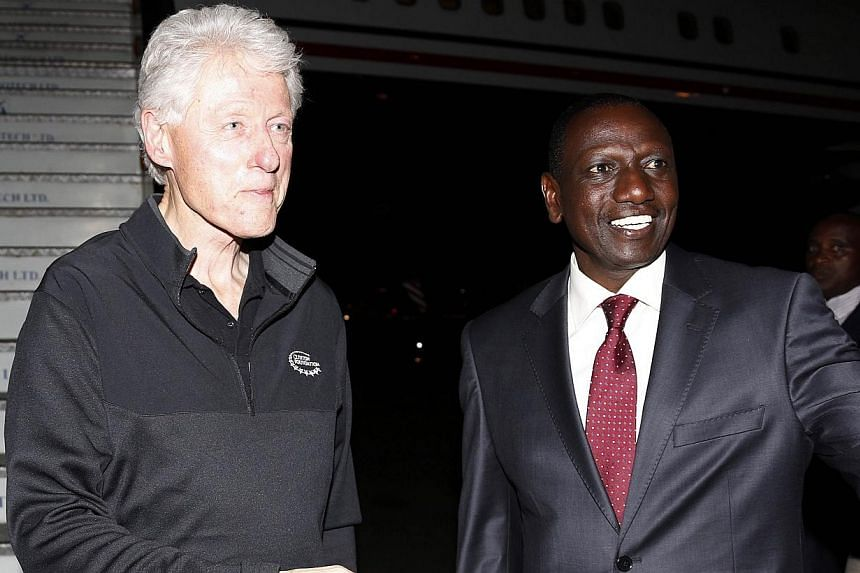 Kenya's Deputy President William Ruto (right) welcoming former US President Bill Clinton last week as he arrived at Jomo Kenyatta International Airport in Nairobi. -- PHOTO: AFP