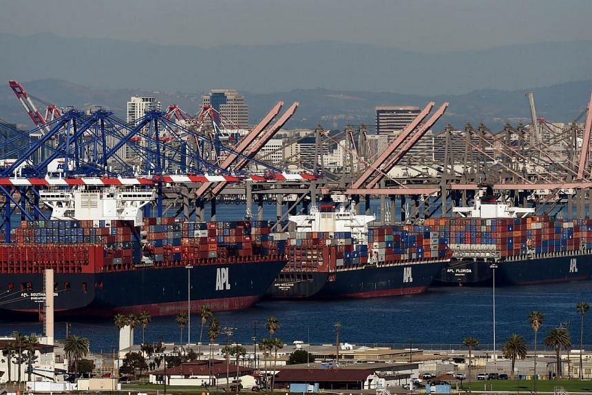 Ships waiting to be unloaded at the Port of Los Angeles in Long Beach, California, on Feb 13, 2015. The US trade deficit swelled in March to a six-year high on a surge in imports from the end of the West Coast port strike backed by the strong dollar.