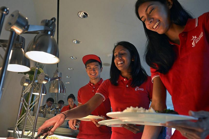 Sports nutritionists and chefs have come together to create high-performance versions of uniquely Singaporean dishes, which will be served to athletes participating in this June's SEA Games. -- ST PHOTO: KUA CHEE SIONG