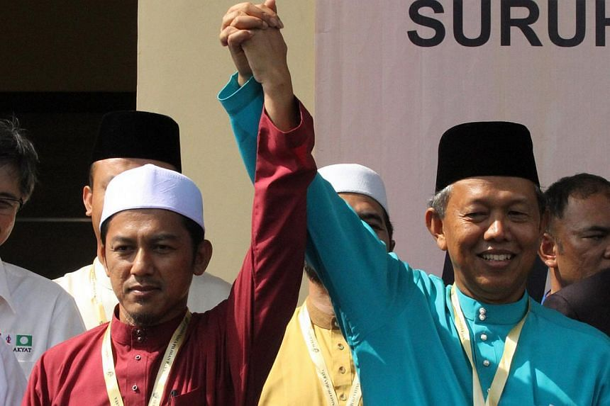 Parti Islam seMalaysia's (PAS) Nazri Ahmad (left) will contest the Rompin by-election on May 5 with Barisan Nasional's (BN) Hasan Arifin (right). -- PHOTO: THE STAR/ASIA NEWS NETWORK