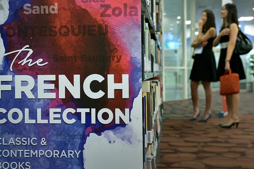 The public will now be able to borrow from the National Library Board's (NLB) collection of more than 1,000 French books, previously available for reference only. -- ST PHOTO: KUA CHEE SIONG