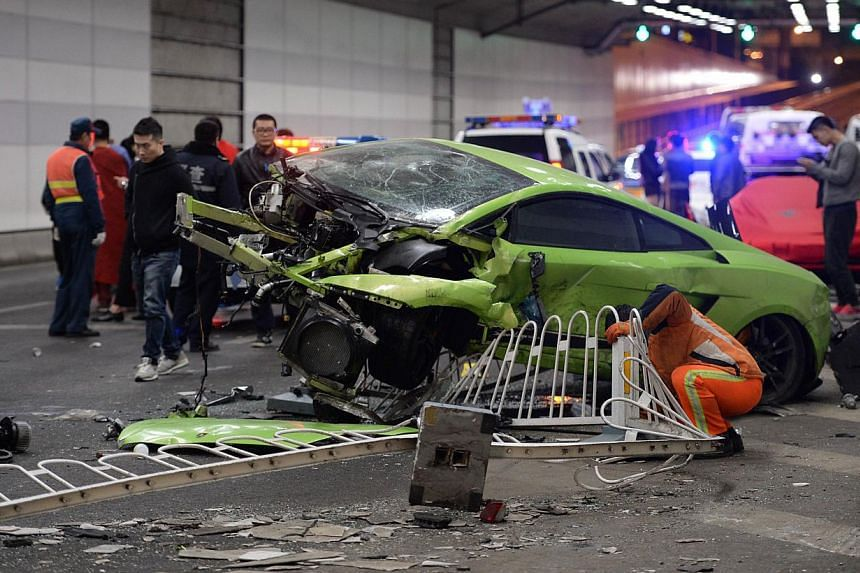 This photo taken early on April 12, 2015 shows a badly damaged Lamborghini car and debris in a tunnel after a crash involving a Ferrari in Beijing. -- PHOTO: AFP