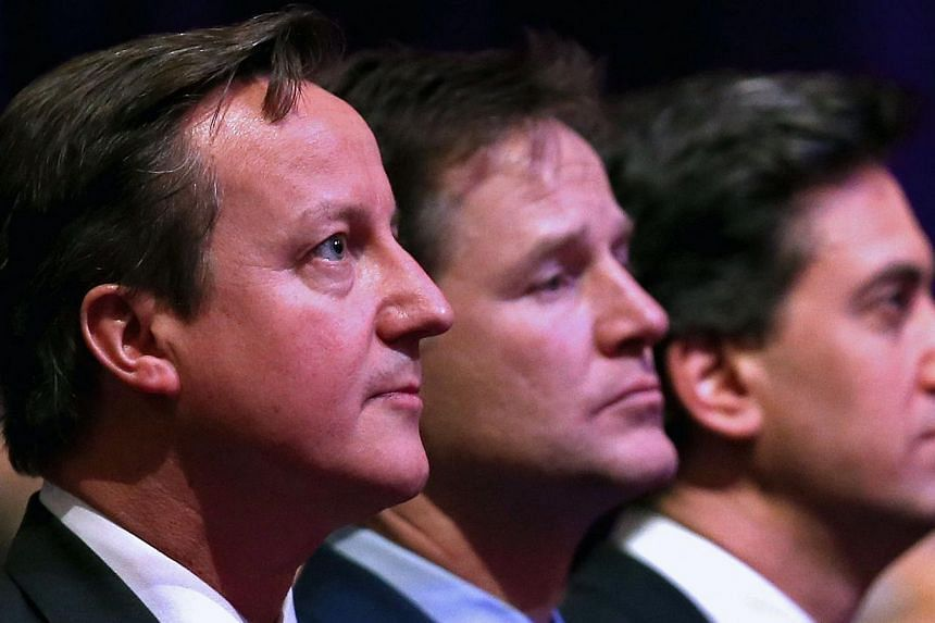 Britain's Prime Minister David Cameron (left), British Deputy Prime Minister Nick Clegg (centre) and leader of the opposition Labour Party Ed Miliband (right) attend a Holocaust Memorial Day ceremony at Central Hall Westminster in London on Jan 27, 2