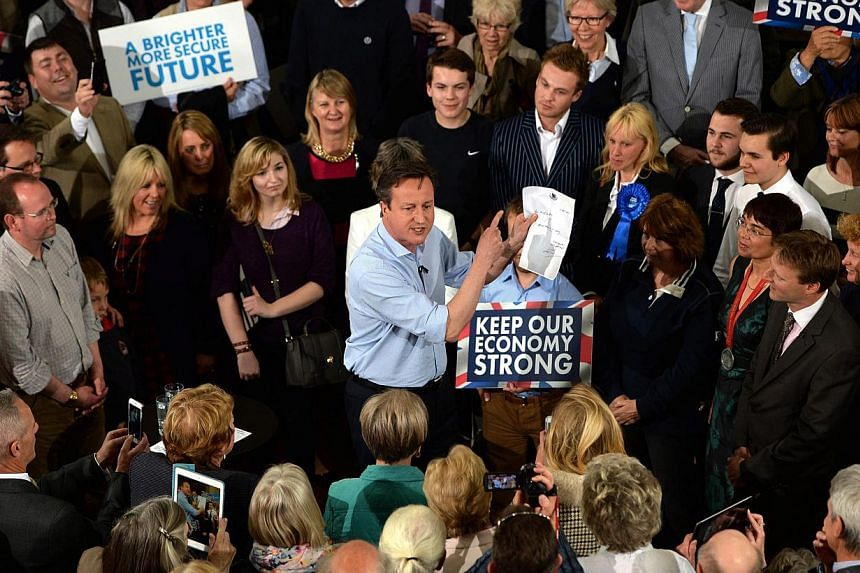 British Prime Minister David Cameron (centre) campaigns at a rally in St Ives, Cornwall, as part of his 36 hour non-stop tour of the UK, Britain, on May 5, 2015. -- PHOTO: EPA