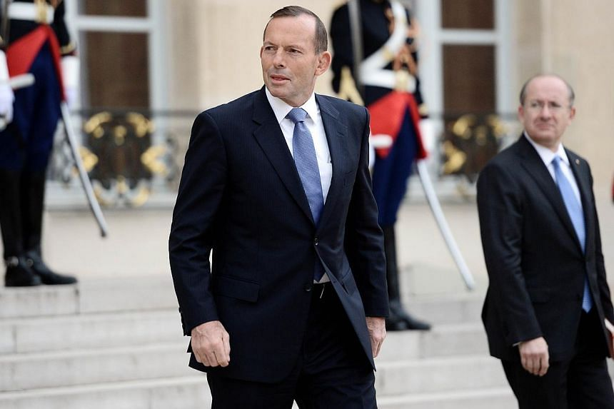 """Australian Prime Minister Tony Abbott leaves the Elysee Palace in Paris after a meeting with France's President on April 27, 2015. Mr Abbott said on Wednesday that he was unaware the gay partner of his ambassador to France was asked """"to wait in the c"""