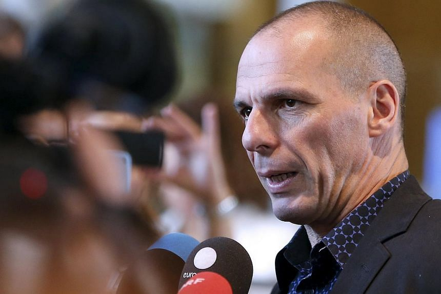 Greek Finance Minister Yanis Varoufakis talking to reporters while leaving the European Commission headquarters in Brussels on May 5, 2015. -- PHOTO: REUTERS