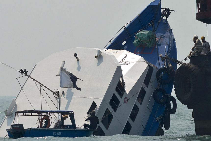 This file picture taken on Oct 2, 2012 shows the bow of the Lamma IV boat partially submerged during rescue operations the morning after it collided with a Hong Kong ferry. Two Hong Kong government officials charged over the city's worst maritime dis