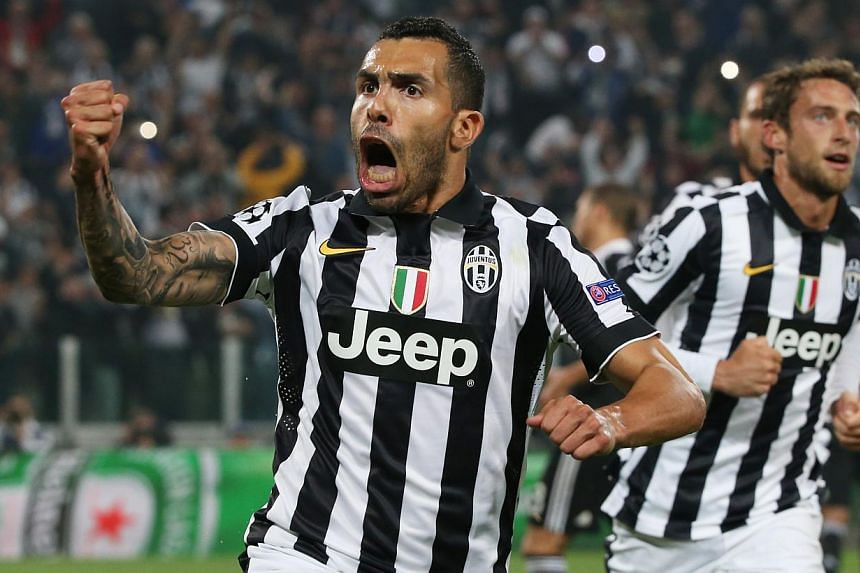 Juventus striker Carlos Tevez celebrates scoring his team's second goal from the penalty spot in their 2-1 Champions League semi-final first-leg win over Real Madrid in Turin. -- PHOTO: REUTERS