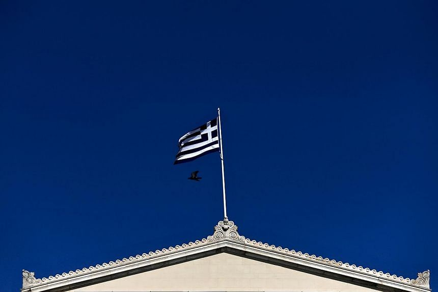 A Greek national flag flying atop the Parliament building in Athens on May 5, 2015. The Greek government has suggested imposing a special levy on the country's 500 richest families to help unlock bailout aid, German newspaper Bild said on Wednesday.