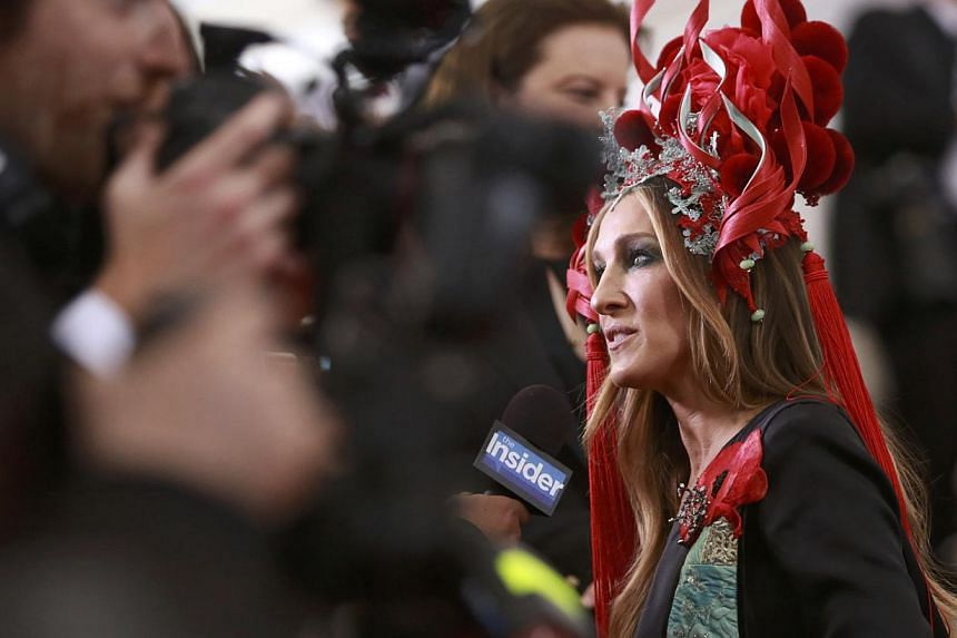 "Actress Sarah Jessica Parker arrives for the Metropolitan Museum of Art Costume Institute Gala 2015 celebrating the opening of ""China: Through the Looking Glass,"" in Manhattan, New York on May 4, 2015. -- PHOTO: REUTERS"