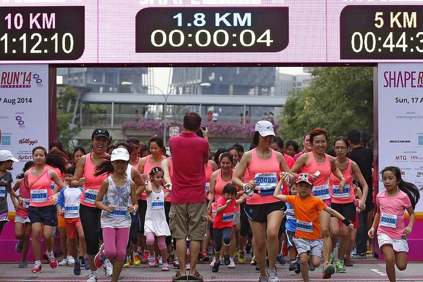 Mothers and their children below the age of 10 make a dash in the new Me and Mini Me 1.8km Fun Run during Shape Run 2015.This year's Shape Run is rolling out two new categories, one of which is a 1.8km Family Fun Run for teams of two to four, i