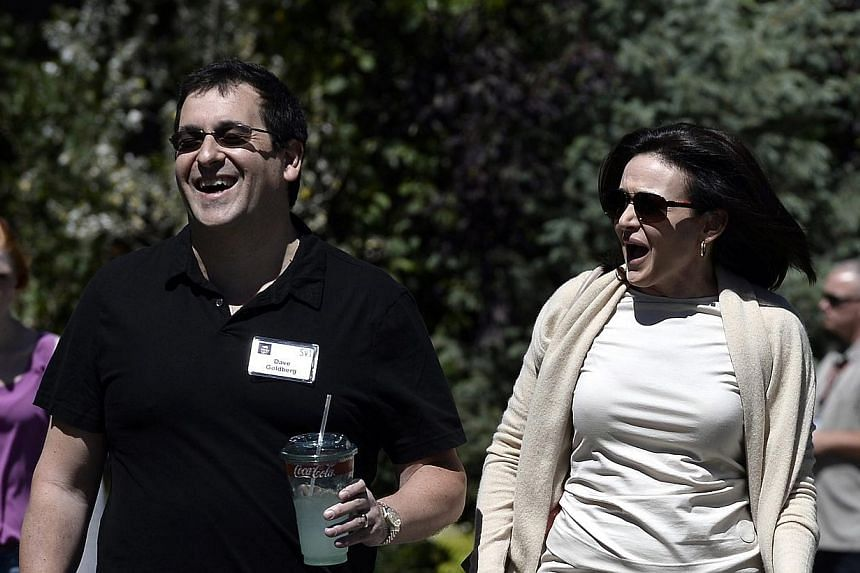 Sheryl Sandberg, chief operating officer of Facebook, and husband David Goldberg (left), chief operating officer of SurveyMonkey, attending the Allen and Company 31st Annual Media and Technology Conference. Sandberg re-emerged in public on Tuesday af