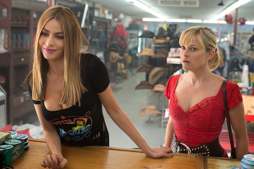 Sofia Vergara (left) plays the wife of a drug boss on the run with a police officer, played by Reese Witherspoon (right). -- PHOTO: WARNER BROS