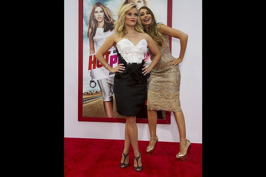 Actresses Reese Witherspoon (left) and Sofia Vergara hamming it up on the red carpet for the premiere of their movie last month in Hollywood. -- PHOTO: REUTERS