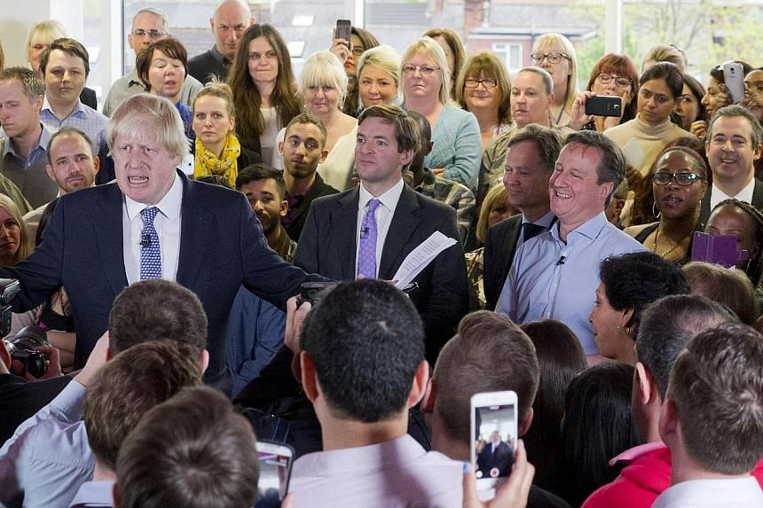 On the campaign trail, London Mayor Boris Johnson (left) was constantly asked if he would replace Mr David Cameron (right) as the next PM. -- PHOTO: AGENCE FRANCE-PRESSE