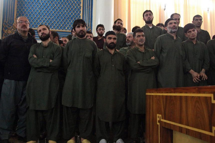 The four were among 49 defendants, 19 of them police officers, on trial in connection with the killing of 27-year-old woman accused of burning a Quran in Kabul. -- PHOTO: EPA