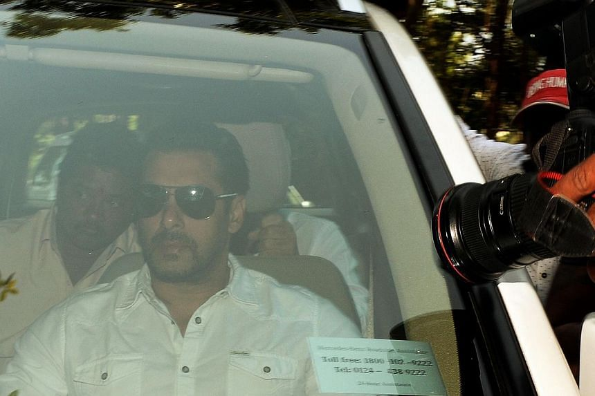 Salman Khan (centre) arriving in a car at a sessions court in Mumbai on May 6, 2015. The Bollywood star was sentenced on Wednesday to five years in prison. -- PHOTO: AFP