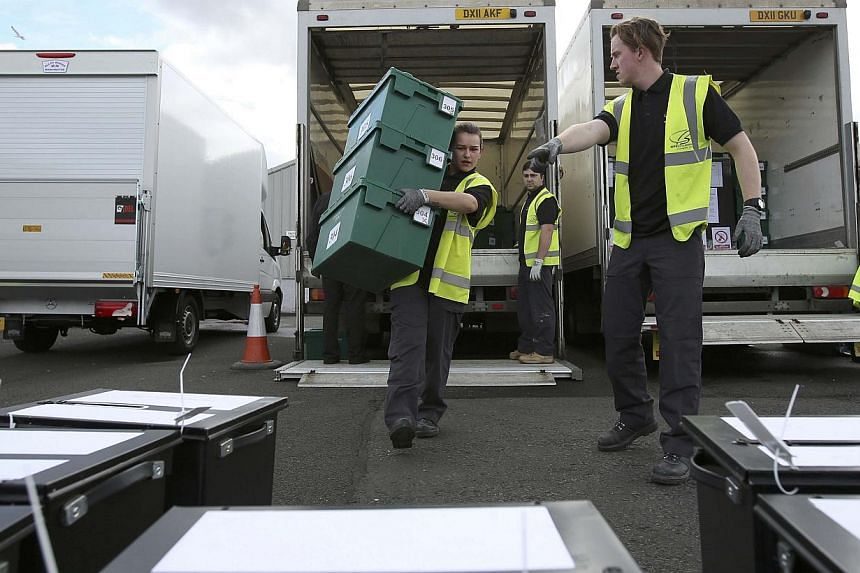 City council workers assemble ballot boxes for distribution ahead of the next day's general election, in Glasgow, Scotland on May 6, 2015.British Prime Minister David Cameron's Conservative Party is one point ahead of the opposition Labour Part