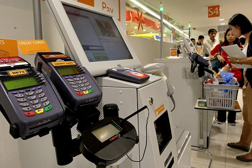 Some new high-tech payment methods such as contactless cards are getting the cold shoulder from Singapore shoppers, who prefer to stick with cash, according to a new study yesterday. -- PHOTO: ST FILE