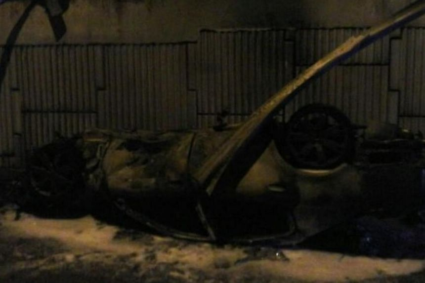 The burnt wreck of the Maserati Quattroporte. -- PHOTO: THE STAR/ASIA NEWS NETWORK