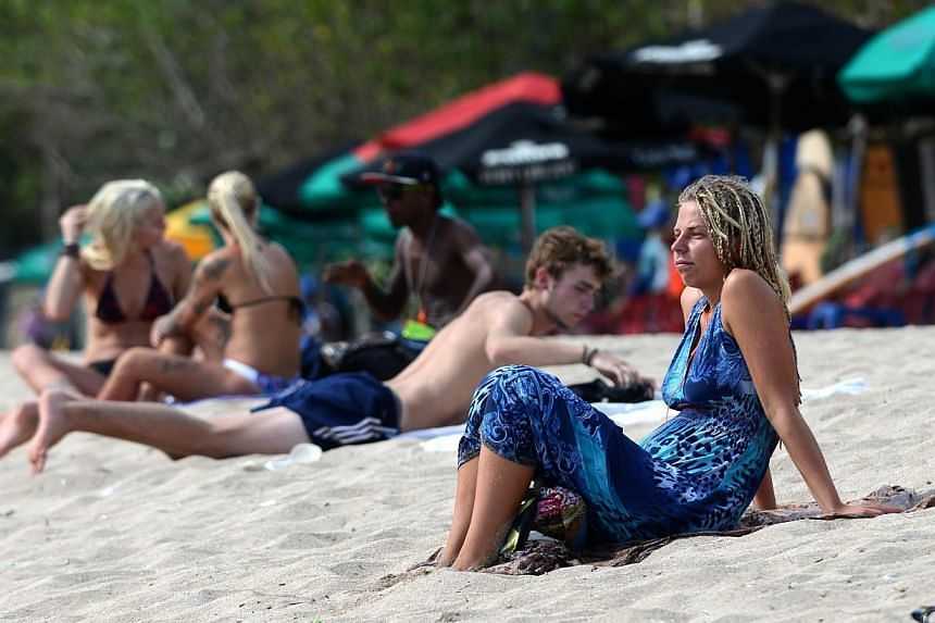 Foreign tourists sunbathing on Kuta beach, Bali island on March 17, 2015.The number of Australian visitors to Indonesia rose in March and the island nation's tourism industry has seen no impact from a Boycott Bali protest over death sentences p