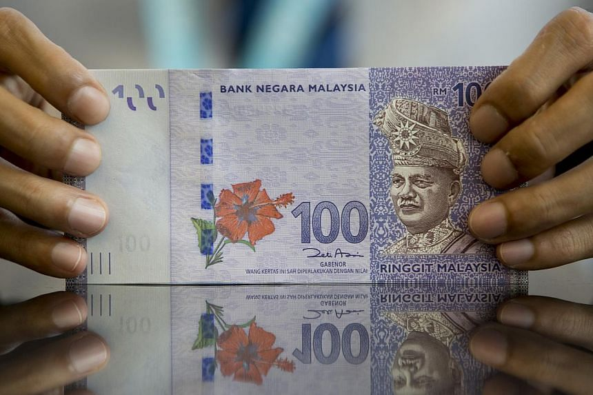 Malaysia's ringgit rose, leading gains in Asia, as a rally in crude prices eased concern that falling revenue will harm the oil-exporting nation. -- PHOTO:BLOOMBERG