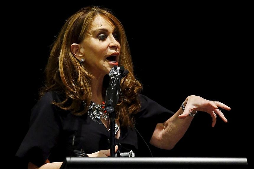 Political blogger Pamela Geller, founder of the American Freedom Defence Initiative, speaks at the Mohammad Art Exhibit and Contest, which is sponsored by the American Freedom Defense Initiative, in Garland, Texas on Sunday before two gunmen opened f