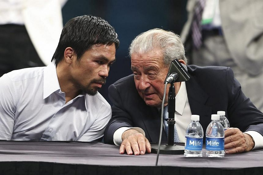 Boxing Promoter Bob Arum (right) with Manny Pacquiao (left) attending a press conference after Pacquiao's defeat by Floyd Mayweather Jr.  following their welterweight unification championship boxing fight at the MGM Grand Garden Arena in Las Veg