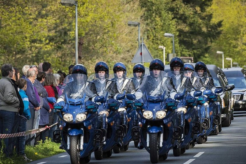 A motorcade with hearses carrying the last remains of Dutch victims of the MH17 plane crash arrive at the Korporaal van Oudheusdenkazerne in Hilversum, the Netherlands on Saturday. -- PHOTO: EPA