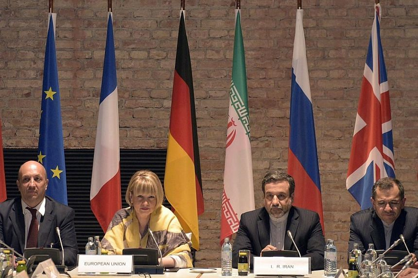 EU-director Helga Schmid (centre left) and Iranian Deputy Foreign Minister Abbas Araghchi (centre right), during talks between France, Germany, Britain, China, Russia, the United States and Iran in Vienna on 24 April 2015. -- PHOTO: EPA