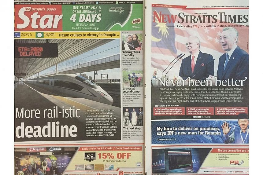 """Page 1 of The Star showed a photo of a bullet train with the punny headline """"More rail-istic deadline"""", while the New Straits Times carried a photo of a smiling Mr Lee and Mr Najib on its front page. -- PHOTO: THE STAR/THE NEW STRAITS TIMES"""