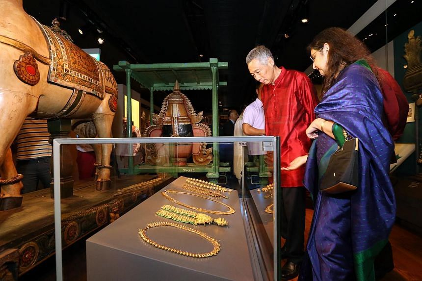 Prime Minister Lee Hsien Loong is brought on a tour of the centre by its director, Dr Gauri Krishnan (right), at its opening on Thursday. -- ST PHOTO: SEAH KWANG PENG