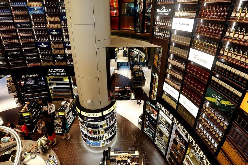 Across its stores at Changi Airport, DFS has expanded its assortment - one of the largest in the region - to over 1,400 products from over 440 spirits, wines and tobacco brands. -- ST PHOTO: CHEW SENG KIM