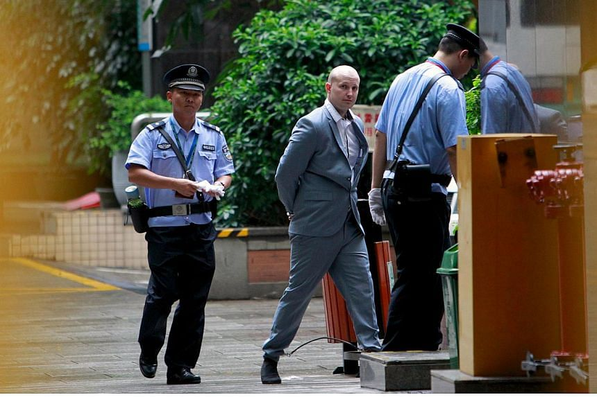 Police escort Australian Peter Gardner as he enters court in Guangzhou, Guangdong province, China on May 7, 2015. He faces a possible death sentence on Thursday on charges of attempting to smuggle millions of dollars worth of drugs out of China. -- P