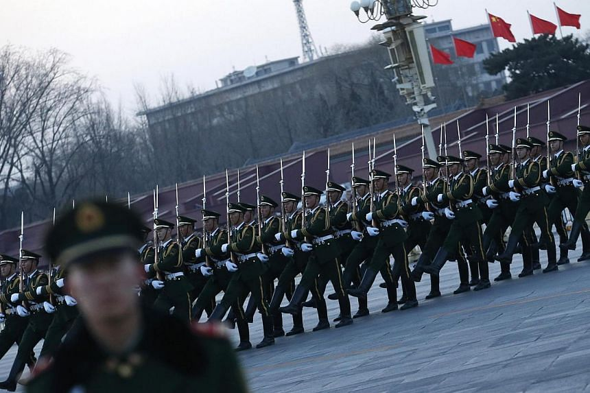 There are some in China's armed forces, the largest in the world, who are not taking the fight against corruption seriously, brushing problems under the carpet and not daring to go after senior officers, its official paper said on Thursday. -- PHOTO: